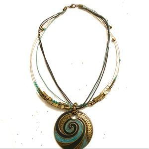 Blue gold medallion necklace